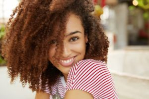 close-up-shot-of-curly-african-american-woman-with-JFUURTV (1)